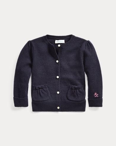 Cardigan in lana con fiocchi sulle tasche