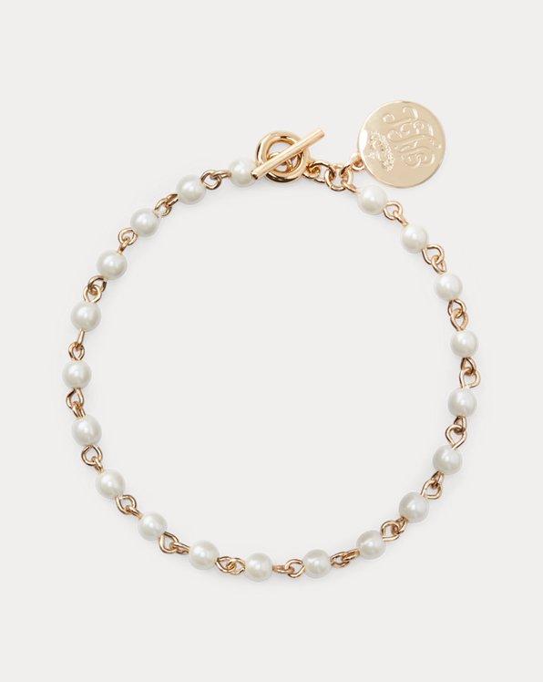 pulsera flexible de perlas doradas